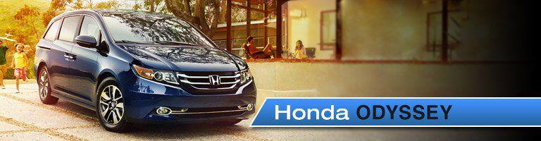 2018 Honda Odyssey parked with family heading towards it
