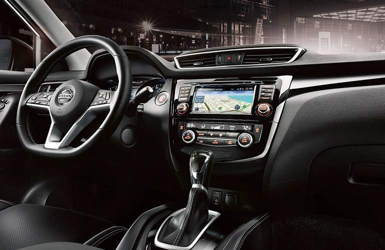 steering wheel and infotainment system in the 2017 Nissan Rogue Sport