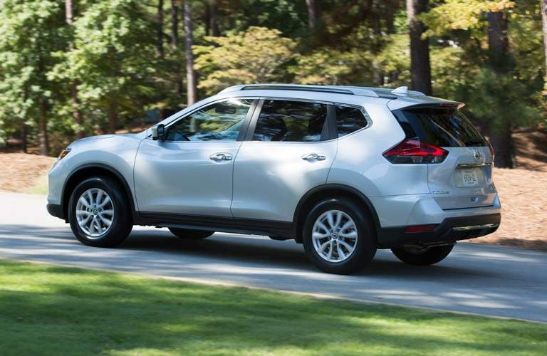 while 2017 Nissan Rogue driving on street