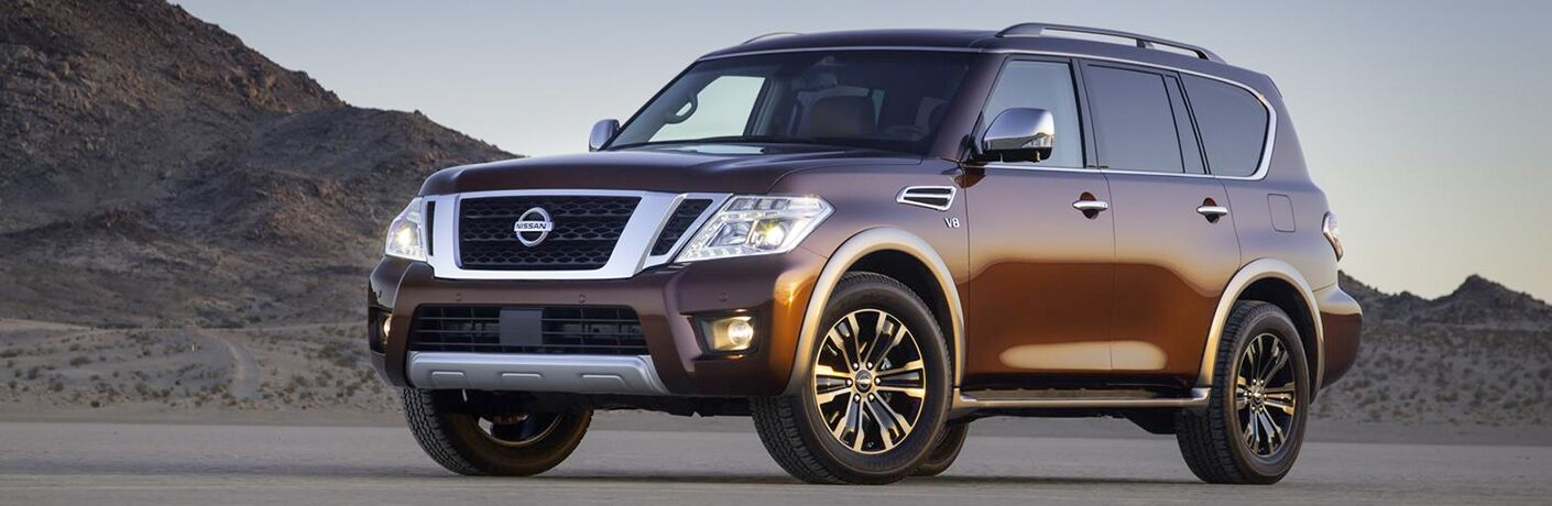 2018 Nissan Armada exterior front quarter view against desert mountain background