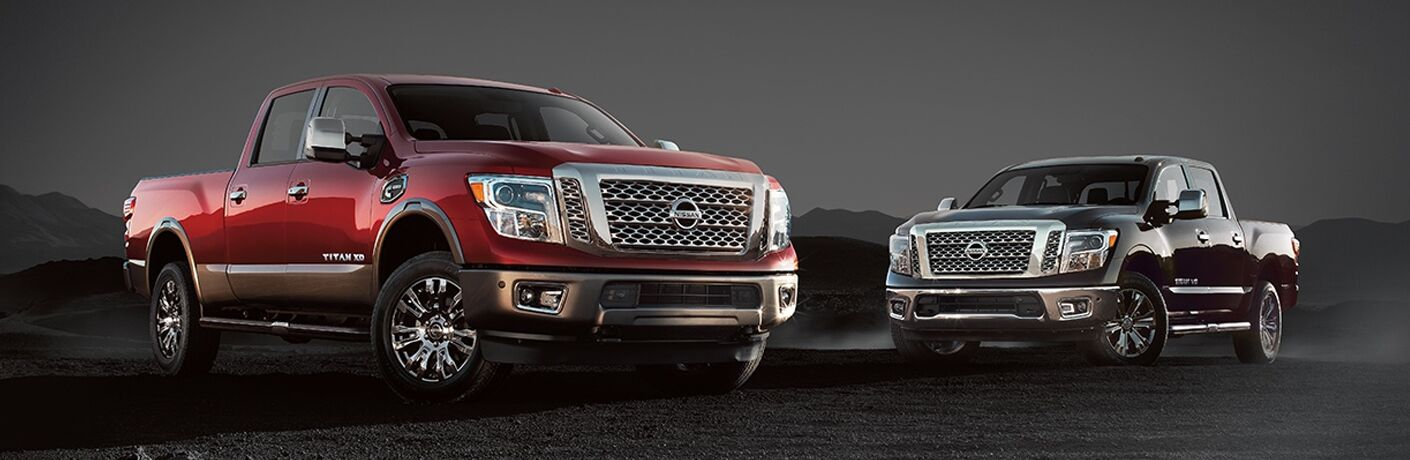2018 Nissan Titan XD and 2018 Nissan Titan SV on dark landscape