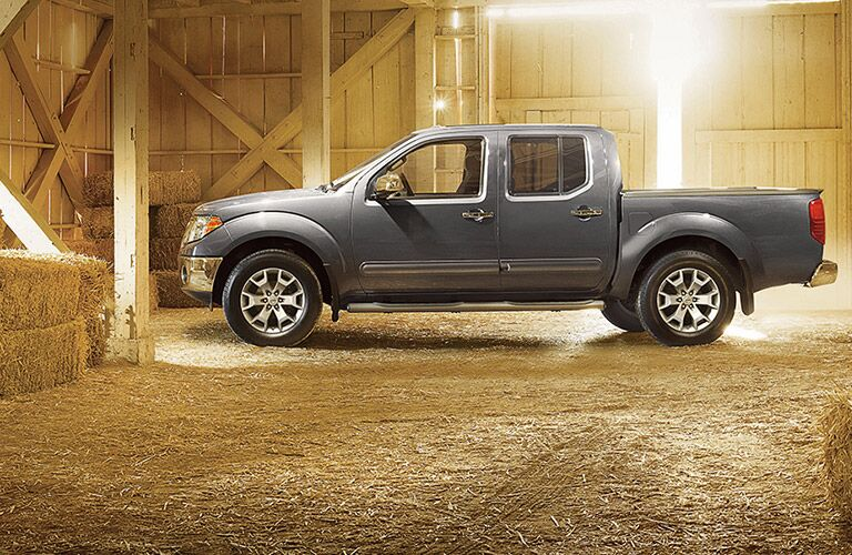 side view of a silver 2019 Nissan Frontier