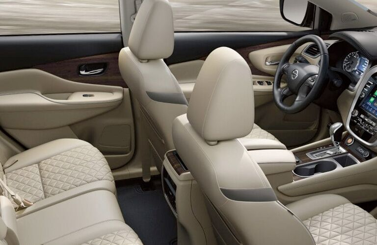 2019 Nissan Murano interior view of front cabin seats and steering wheel with partial back cabin seats and partial dashboard