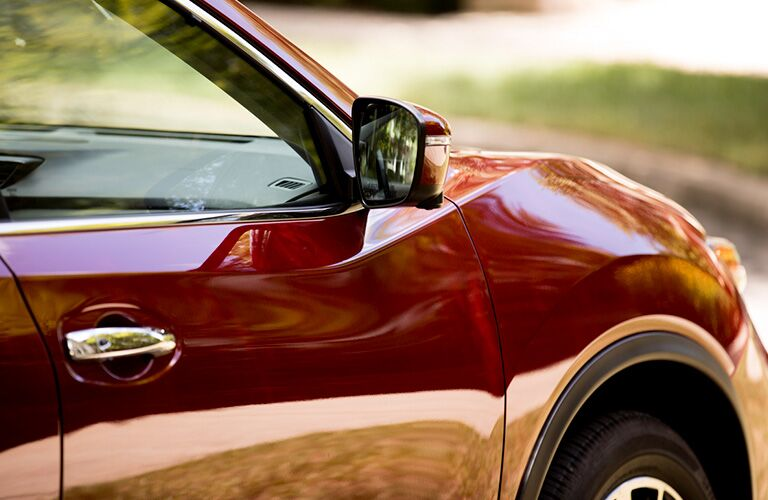 front passenger door on a red 2019 Nissan Rogue