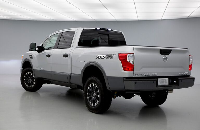2019 Nissan Titan XD exterior back fascia and drivers side in gray room