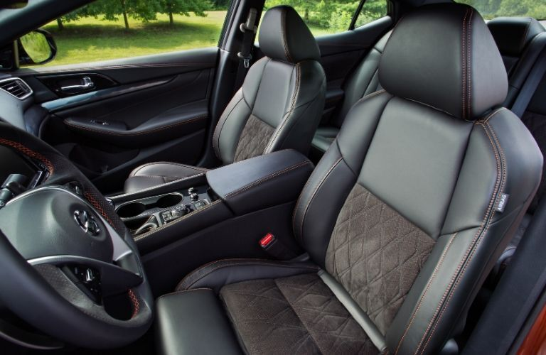 Interior view of the front seating area inside a 2020 Nissan Maxima