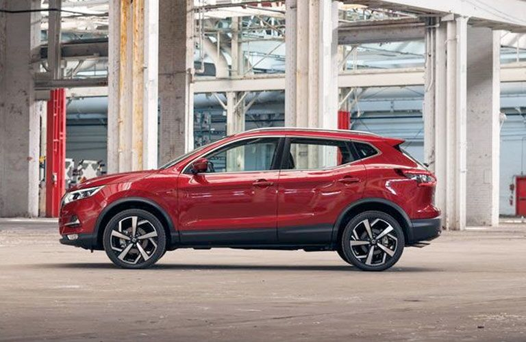 2020 Nissan Rogue Sport exterior driver side profile in empty outside parking garage
