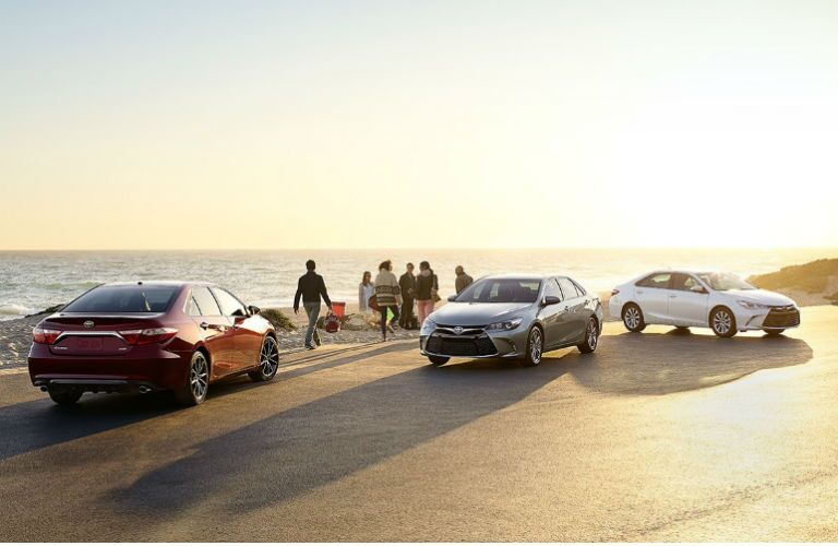 2016 Toyota Camry bold exterior design on the beach with friends