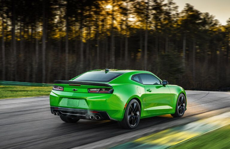 2017 Camaro green speeding down a track