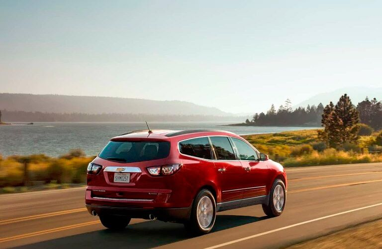 2017 Chevy Traverse red from the back driving