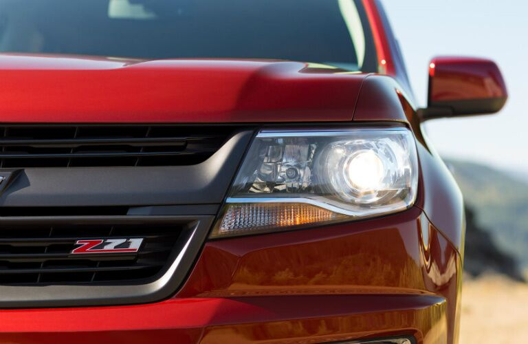2017 Chevy Colorado red grille headlight front view