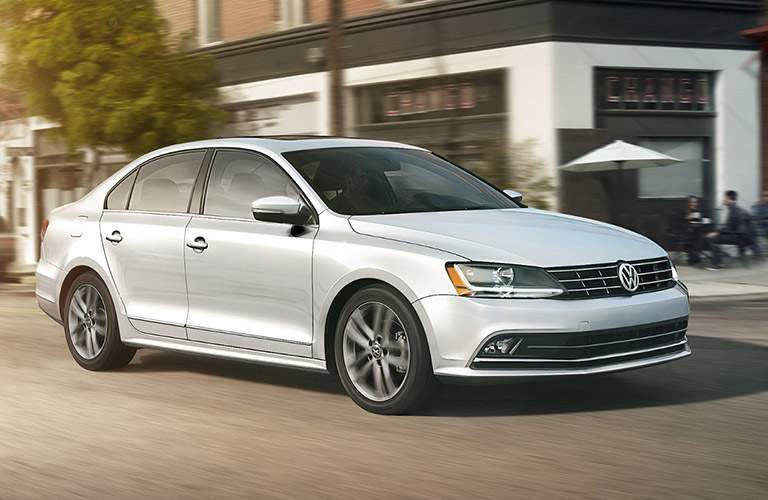 white volkswagen jetta driving in city