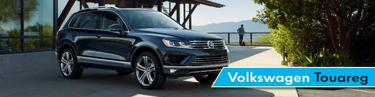 black volkswagen touareg by canopy