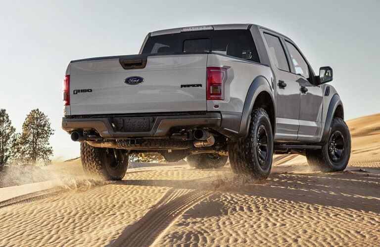 2017 Ford F-150 Raptor from the rear over sand