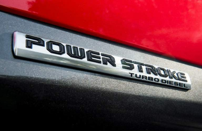 close up of the Power Stroke logo on a red 2018 Ford F-150 Diesel