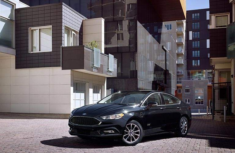 black 2018 Ford Fusion Energi parked in front of a building