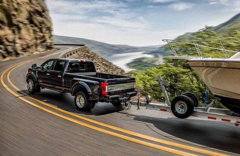 rear view of a black 2019 Ford F-450 Super Duty towing a boat