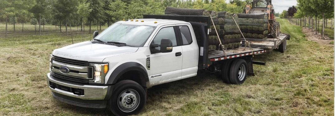 2019 Ford Super Duty F-550 hauling wood and machinery