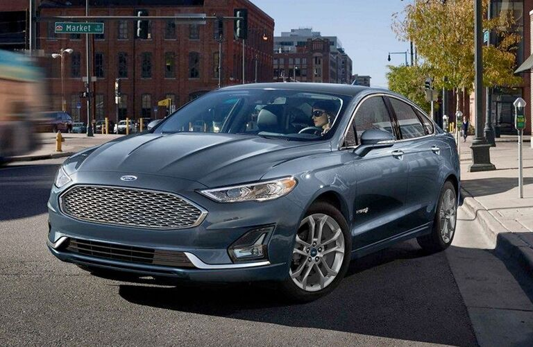 side view of a blue 2019 Ford Fusion Hybrid