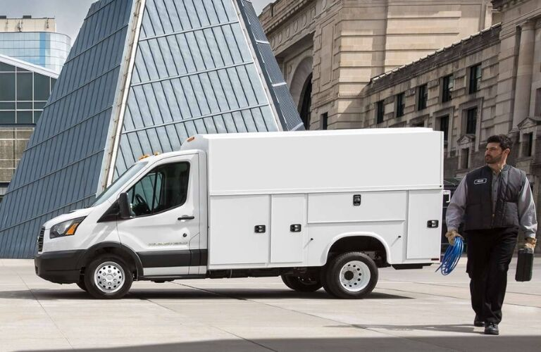 2019 Ford Transit Cutaway in Front of Cityscape