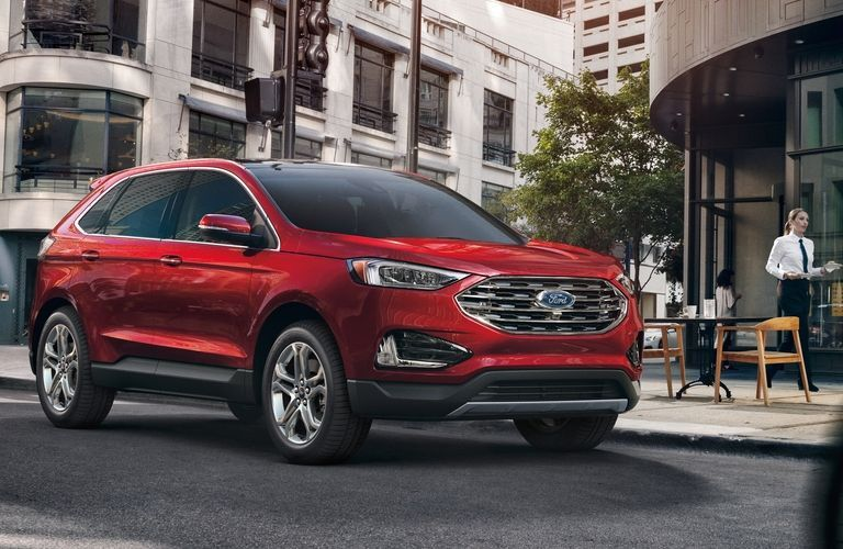 2020 Ford Edge driving down city street