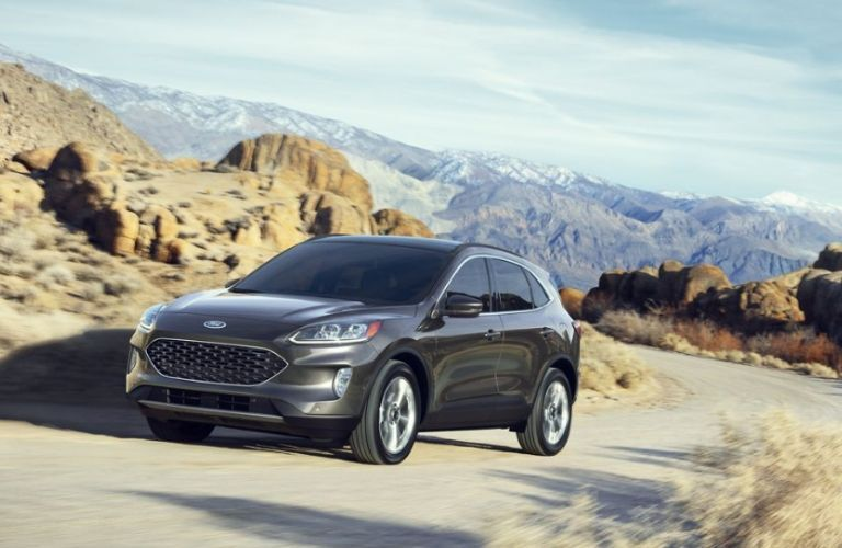 2020 Ford Escape driving up road in rocky terrain