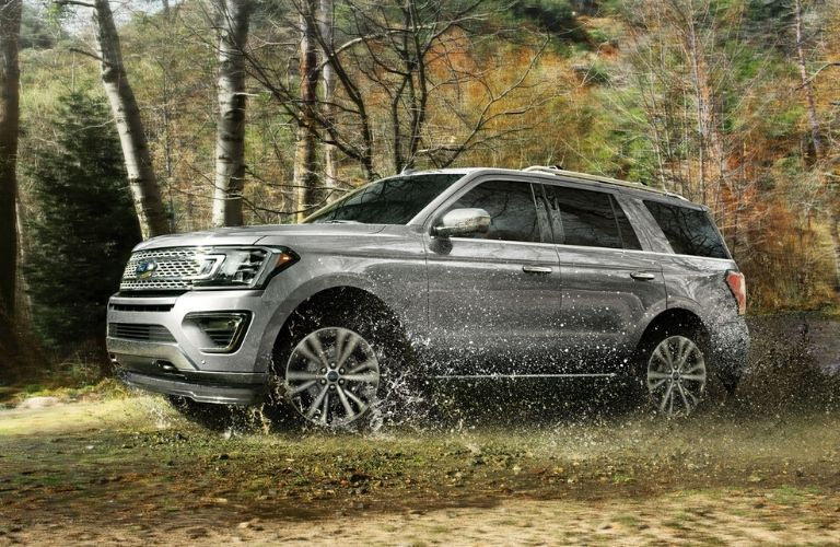 2020 Ford Expedition Platinum driving through wet ground
