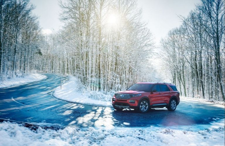 2020 Ford Explorer driving on winding winter road