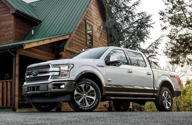 2020 Ford F-150 by cabin in forest