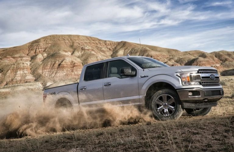 2020 Ford F-150 driving uphill on dry terrain