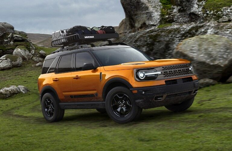 2021 Ford Bronco Sport on grassy field through rocky landscape