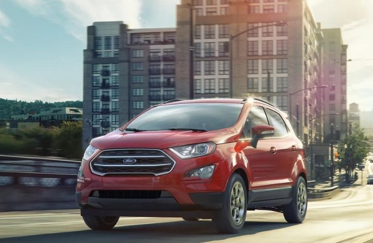 Red 2021 Ford EcoSport on a city road