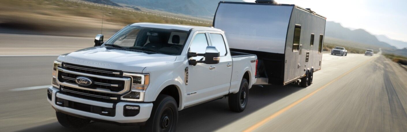 2021 Ford F-350 Super Duty towing a camper