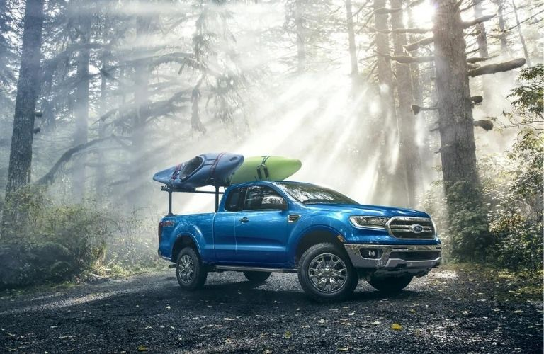 Blue 2021 Ford Ranger parked in a forest.