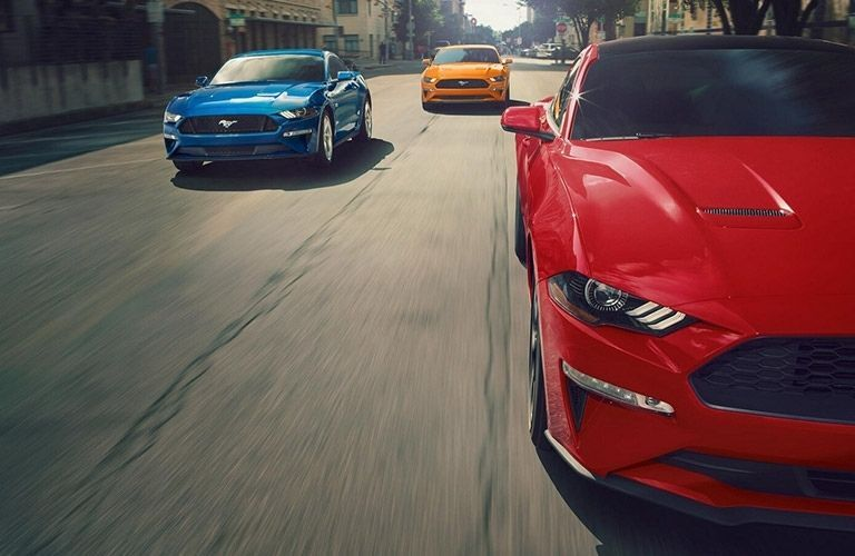 2021 Ford Mustang in various colors on road