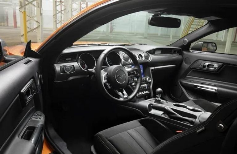2021 Ford Mustang interior view of steering wheel and console