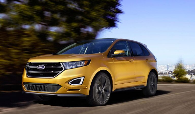 yellow ford edge on the road