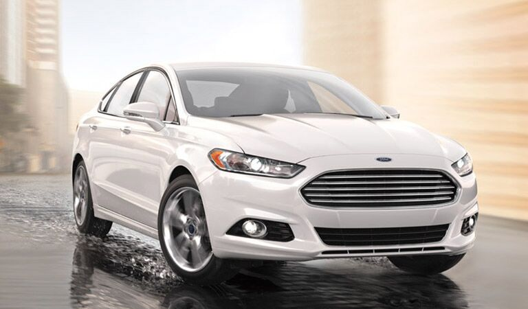 White Ford Fusion driving through water