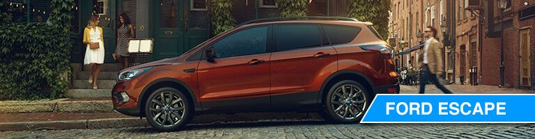 side view of a dark orange Ford Escape