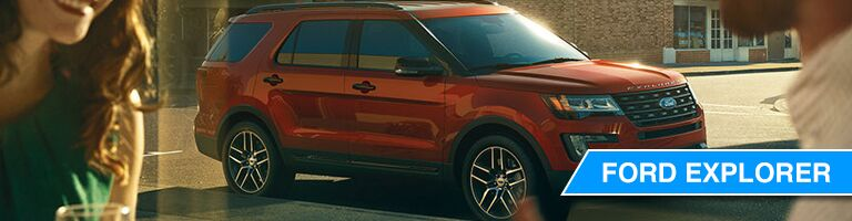 side view of a dark orange Ford Explorer