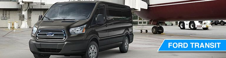 black Ford Transit Van parked at an airport