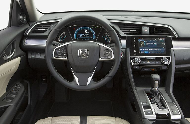 Interior View of Dashboard and Steering Wheel in 2017 Honda Civic Sedan