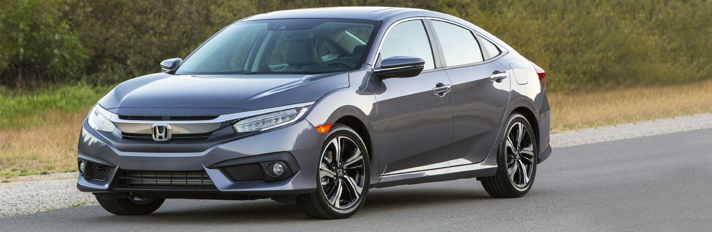 A front left quarter photo of the 2018 Honda Civic parked on the road.