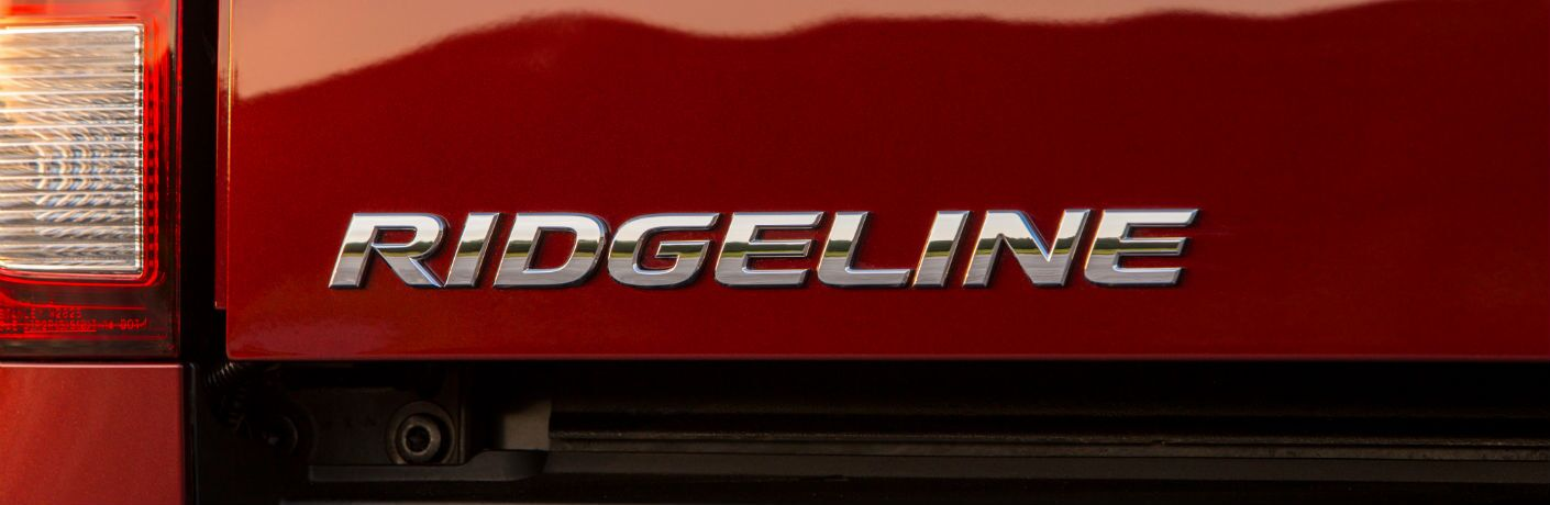 A close up photo of the Ridgeline badge on the tailgate of the 2019 Honda Ridgeline.