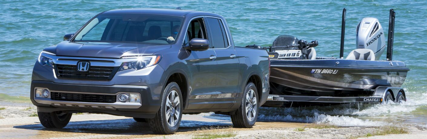A photo of the 2019 Honda Ridgeline pulling a boat out of the water.