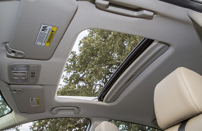 An interior photo of the sunroof that is available in some upper trims of the 2018 Honda Civic.