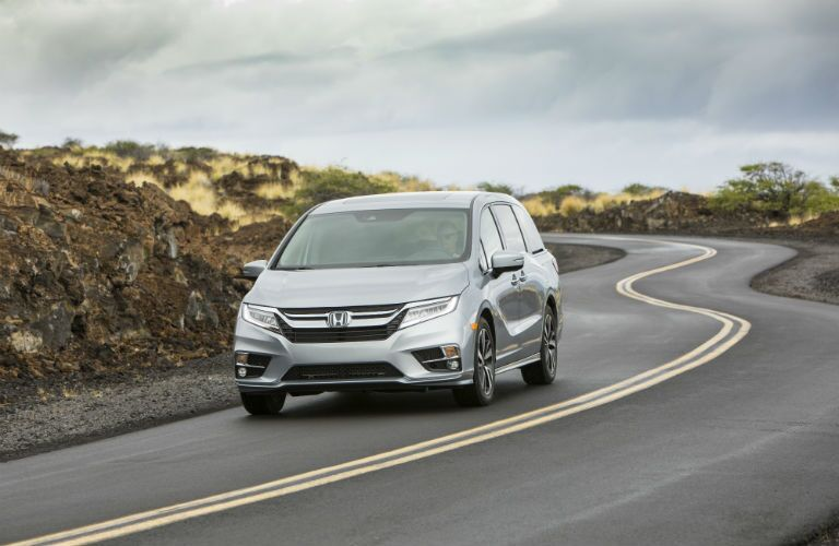 A front photo of the 2019 Honda Odyssey on the road.