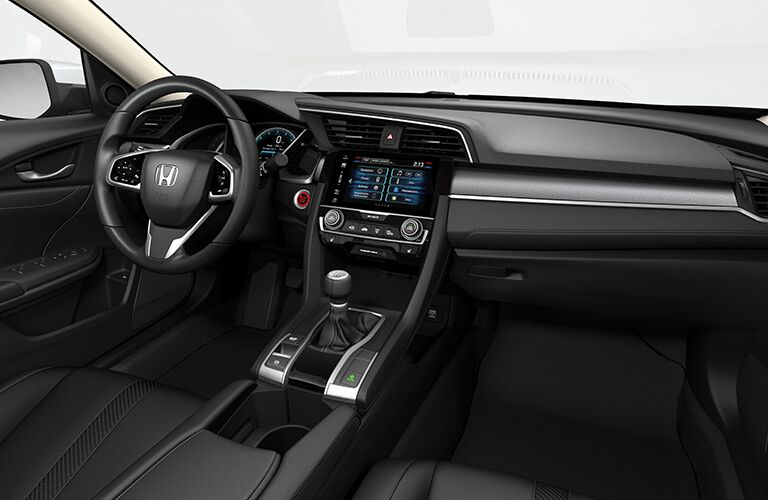 An interior photo of the dashboard in the 2018 Honda Civic with a lot of available technology on display.