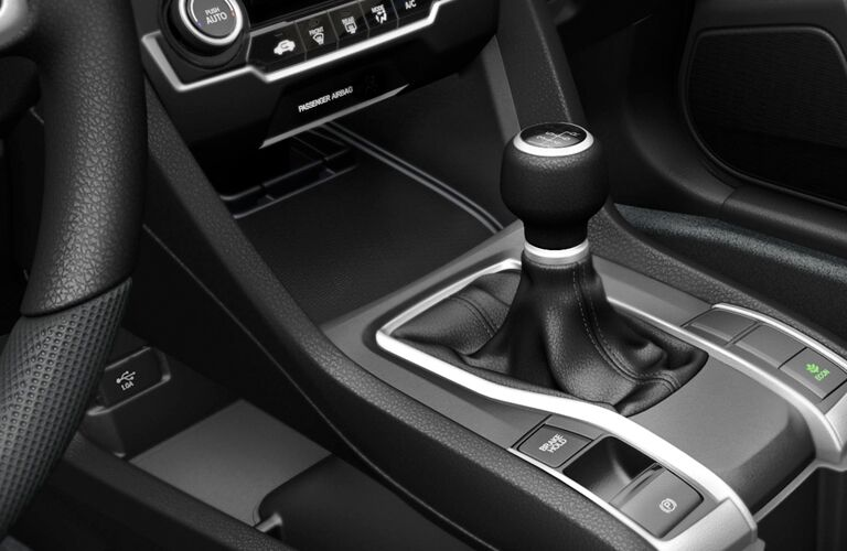 A photo of the gear-shifter for the six-speed manual in the 2018 Civic.