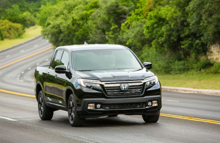 A head-on photo of the 2019 Ridgeline on the road.